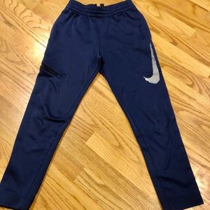 Nike blue dri-fit joggers with Nike symbol
